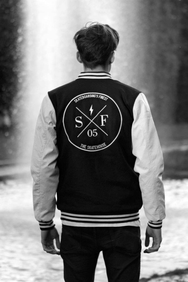 oldschool college jacket with emboidered signature logo at the center backside and a small one on the left chest