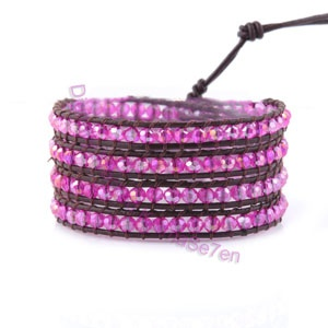 Add a splash of colour to your outfit with our K7 Leather Wrap Bracelets. Pink Iridescent beads catch the light and sparkle. Buy yours today at karmase7en.com