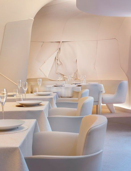 The walls of Sur Mesure par Thierry Marx look as if they're lined with layers of rough-cut white canvas