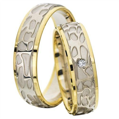8 karats guld/hvidguldsringe fra www.bartoli.dk i et meget unikt og særpræget dyremønster. Dameringen er besat med en diamant. Ringene kan ses direkte via dette link her http://www.bartoli.dk/shop/vielsesringe-i-8-3436p.html