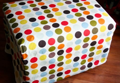Easy ottoman slipcover pattern! I think I'll try something similar as a cover for some ugly plastic bins that have nowhere to hide.
