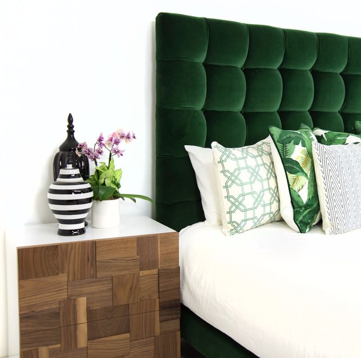 A gorgeous master bedroom detail with a charming tufted headboard.