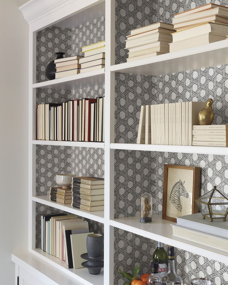 Use your wallpaper to decorate the inside of your shelves | Cayman Cork Wallcovering via Serena & Lily