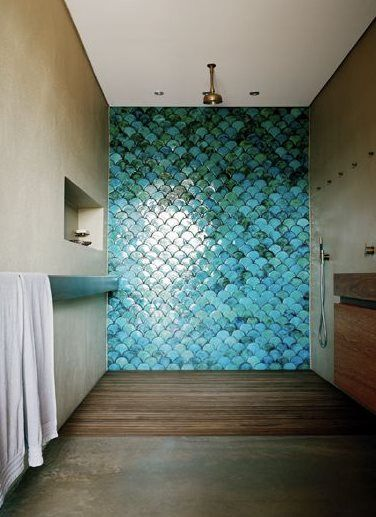 Absolutely beautiful shower.  Especially love the turquoise fishscale tiling.