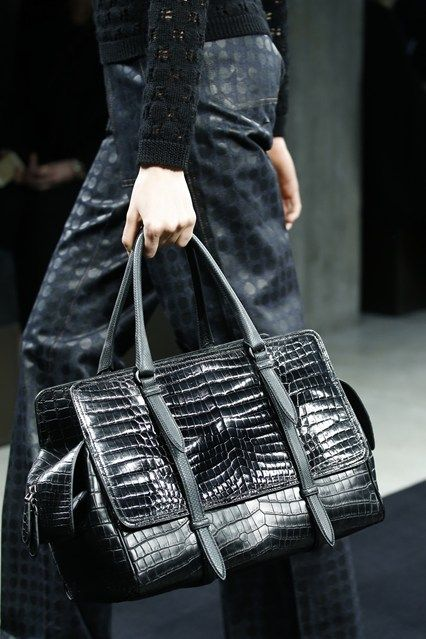 Bottega Veneta with its reptile print bag - Do you want to stylishly transition from summer to autumn, click on this link to read more about the Fall/Winter fashion trends of the woman's most trusted accessory: the B A G => http://www.bagatyou.com/top-10-bag-trends-fallwinter-2016/