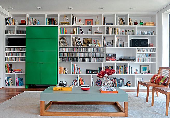 LOVE it - that big green thing is a mini coffee bar. I just love how the shelves are built in around it.
