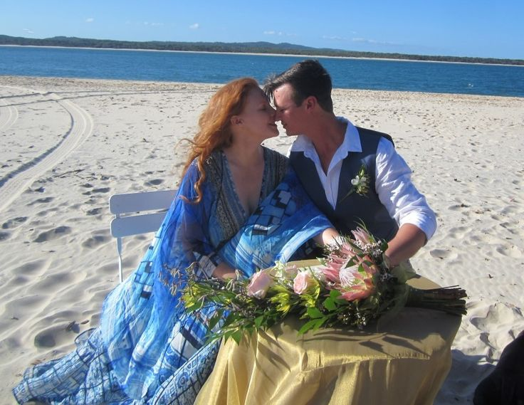 Natalie and Kahl married on a glorious day at Inskip Point with Fraser Island in the background.