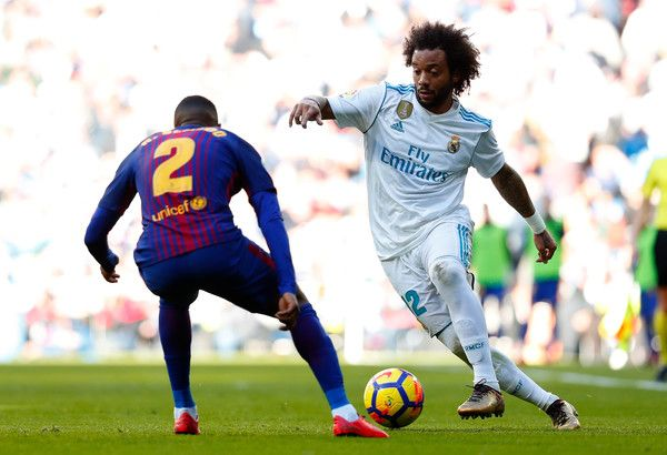 Marcelo of Real Madrid attempts to get past Nelson Semedo of Barcelona during the La Liga match between Real Madrid and Barcelona at Estadio Santiago Bernabeu on December 23, 2017 in Madrid, Spain.
