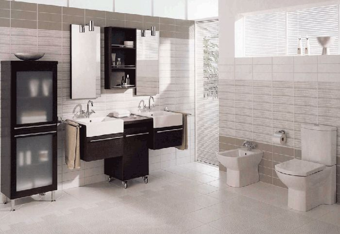 modern minimalist bathroom using neutral colors of black, white and gray. the cabinets here are simple yet stylish.