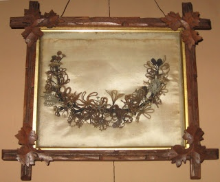 Hair wreath on display at the Skolfield-Whittier House,  probably made by Eugenie Skolfield Whittier or her sister Augusta Marie Skolfield.