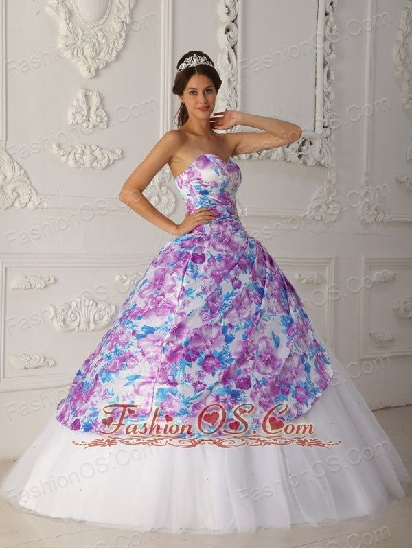 Perfect for a tea party theme quinceanera, vintage Multi-color Quinceanera Dress Sweetheart Tulle Appliques A-line  Strapless dresses are one of the sexier styles on the market today. The sweetheart neckline bodice with colourful printed fabric down to the gown expresses an elegance.
