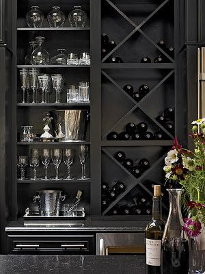 Black bar with wine storage, dramatic. Love this look, just wouldn't need it as a bar.