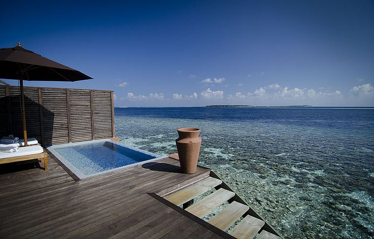 The Water Villa at Lily Beach Resort, Maldives - Built out over the water, with your own private spa, and stairs down to the sea, for impromptu snorkling...