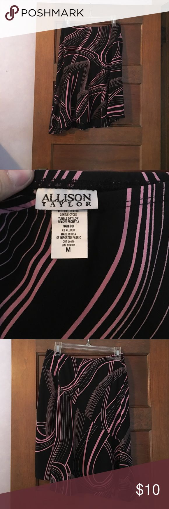 Women's stretch skirt. Size medium. Women's skirt. Stretchy. Size medium. Black and light pink. Asymmetrical. (First pic is front, last pic is back) Allison Taylor Skirts Asymmetrical