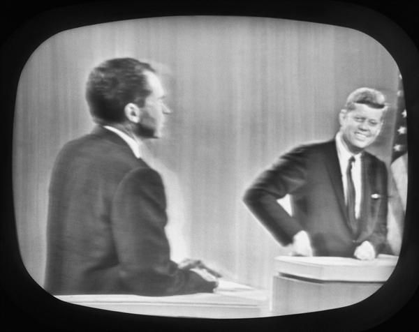 On September 26, 1960, the first televised debate takes place between presidential candidates Richard M. Nixon and John F. Kennedy.