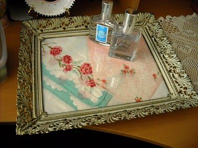 Put vintage handkerchiefs in an old frame for a cute tray! I have a whole bunch of my grandmother's lovely handkerchiefs. :)