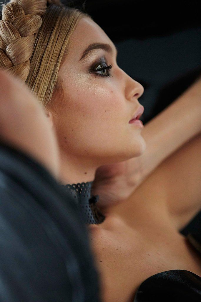 Gigi Hadid puts the finishing touches on her look for the 2015 Pirelli calendar.