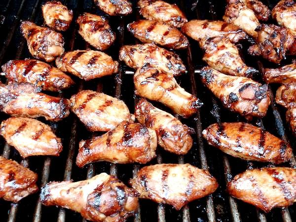 Grilled Chicken Wings Recipe -  For the marinade: 6 lbs chicken wings, cut at joints and wing tips removed 1 cup of Low sodium Soy Sauce 1 cup of Italian Salad Dressing 1 tsp garlic powder 1/2 tsp ground ginger  For the hot sauce: 1/2 cup of hot sauce 1/2 cup of butter, melted
