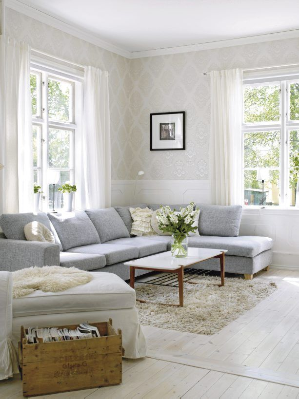 Like the light tone on tone wallpaper in this living room. Gray sofa. http://cococozy.com