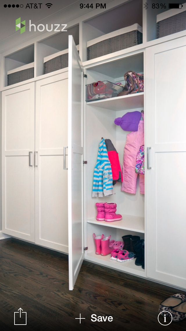 IDEA: closed mudroom doors in light color so it doesn't make room feel too big.  Could use pre-fabricated cabinets.  Cubbies or drawers on the BOTTOM though, not on the top so kids can reach.