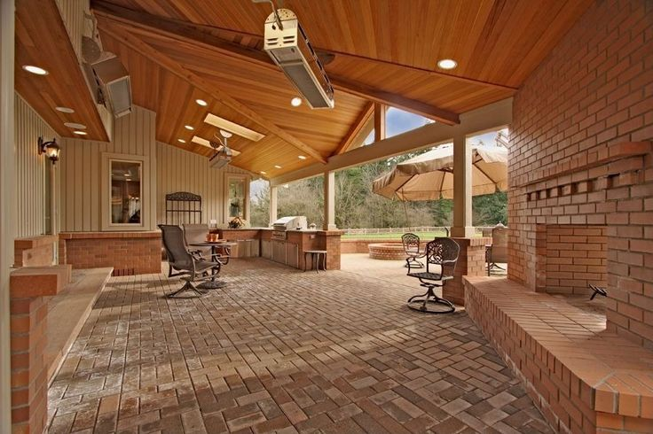 Transitional Porch with Outdoor kitchen, Wrap around porch, Fence, outdoor pizza oven, exterior tile floors, Fire pit