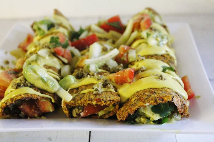 <p>These vegan enchiladas are packed with chunky salsa of avocado, tomato, onion, and cilantro, mixed with a walnut taco meat, spiced with cumin and coriander, all wrapped up in raw tomato-corn tortillas and covered in a creamy cashew cheese sauce.</p>