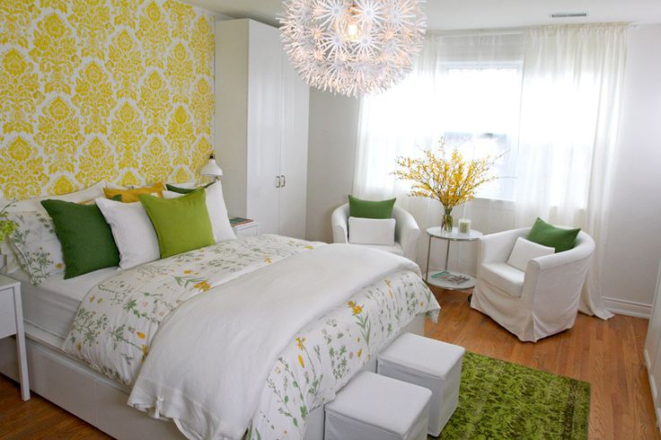 Ikea's second life Silkerborg lime-green rug sets the tone for the room with pops of green and yellow spread throughout the room. The long white drapes on the window also help frame the room into a spa-like feel, instantly relaxing you as you enter.