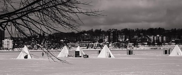 Annual Ice Fishing Derby on Lake Simcoe, Ontario, Canada.  This is only a…