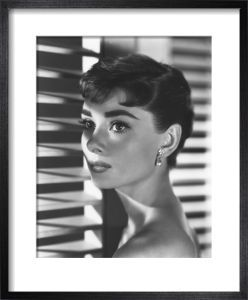 Audrey Hepburn, 1954 by Bud Fraker  £72.52 54 x 44.6 cm framed size 40 x 32 cm image size Black stained ash box frame (1.50 cm), Off-white mount (5 cm), Glass
