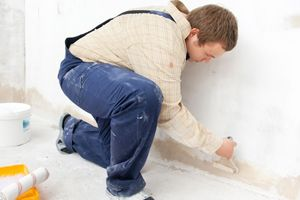 When painting garage walls, is it better to use interior or exterior paint? See why one type of paint is superior to the other for painting garage interiors.