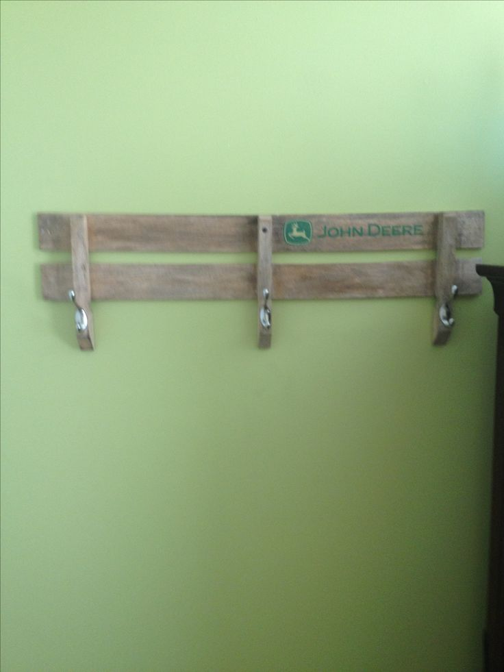 John Deere wagon side repurposed for a coat rack.