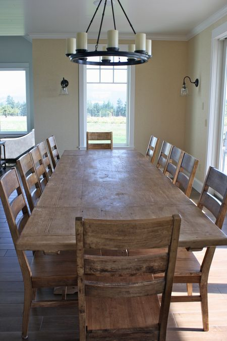 Farmhouse dining table...note:  purchased ikea stornas dining table with ladder back chairs and gives the same feeling of this pic. without the high price. Only $400 for the table.