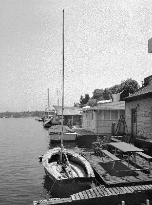 Sailboat docked at houseboat, 2001Sailboats Dock