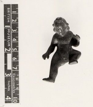 Copper alloy figurine: Figurine of naked child with long hair, probably the infant Bacchus.