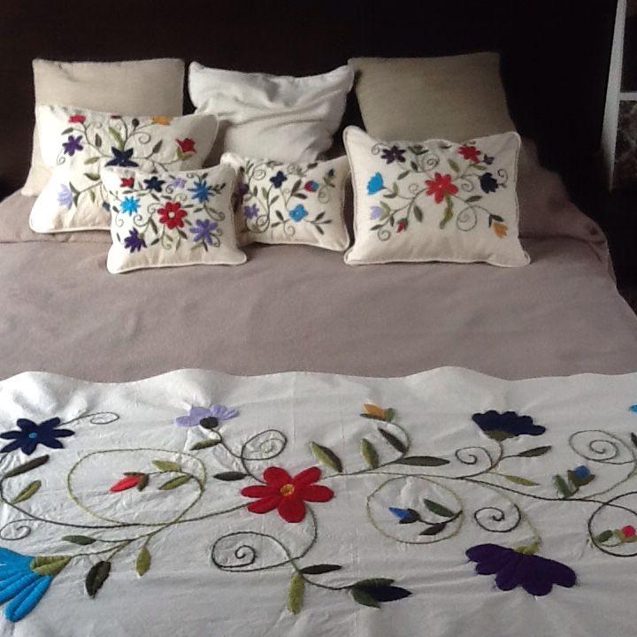 Pie de cama y almohadones
