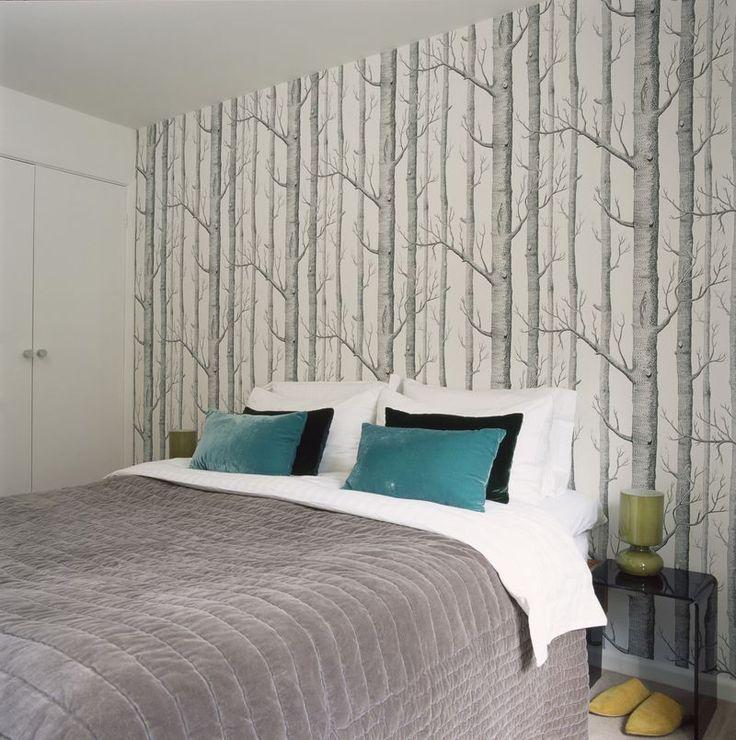 Bedroom with birch tree wallpaper.