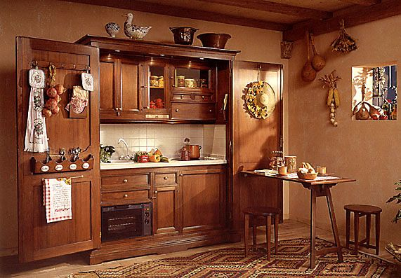 Mueble organizador de cocina que oculta enseres y equipos for Mueble organizador