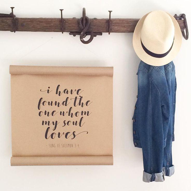Hanging paper scrolls using inspiring quotes or bible verses.