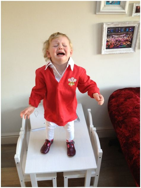 Toddler crying in a WRU jersey