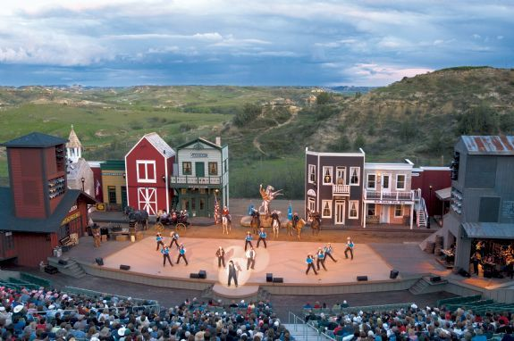 Medora, ND. Entrance to the Theodore Roosevelt National Park and home of the Medora Musical. Free ranging horses and buffalo herds.