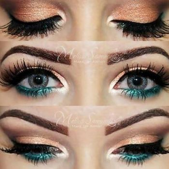 Peachy gold shadow, teal shadow under the eye... Love the pop of teal with the gold!