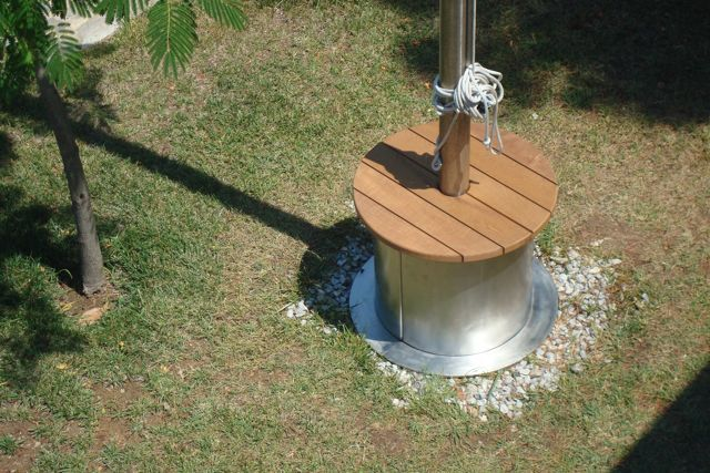 Stainless steel (304L) table with teak top at mast base. #stainlesssteel #metalwork #stainlesssteeldesign #outdoortable