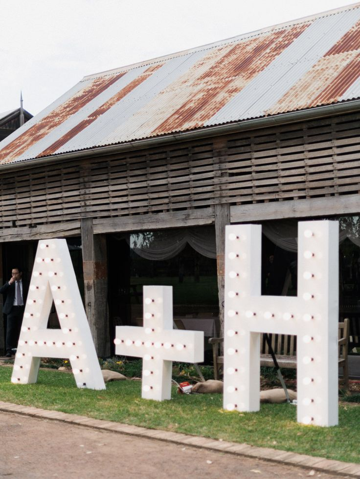 How great are these light up letters! It is one way to add a bit of chic to the rustic exterior.   The initials of the Bride + Groom
