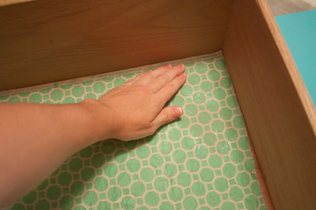 Lining drawers with fabric using liquid starch.