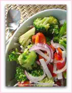 Cold Broccoli Salad With Red Bell Peppers, Radish, Spanish Onion Dressed With An Asian Inspired Marinade.