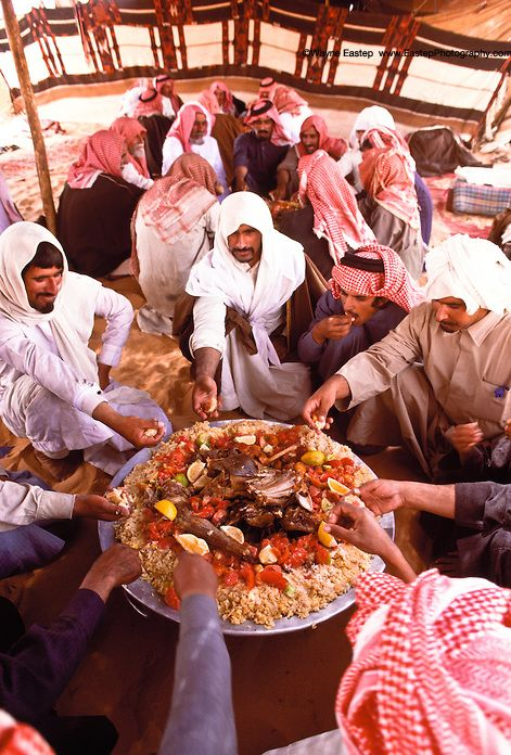Typical meal of lamb and rice called kapsa.  The main meal of the day is eaten communally. Shammar tribe, Nafud Desert, Saudi Arabia