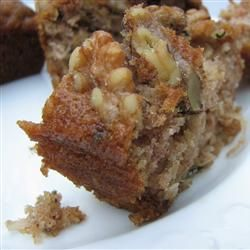 Pineapple Coconut Zucchini Bread: in the oven right now. Batter tastes delicious. :D Swapped 1/2 cup of the oil for half a cup of cinnamon applesauce. Sprinkled some toasted shredded coconut on top for extra coconut flavor.