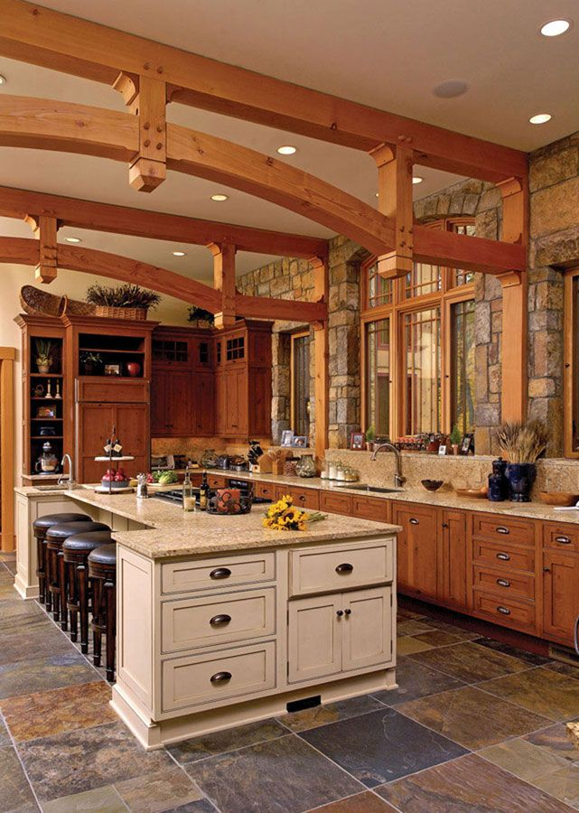 **BIG SLATE FLOOR- stone archs mimic arch over our stove- Timber Frame Interior Design - Normerica Authentic Timber Frame