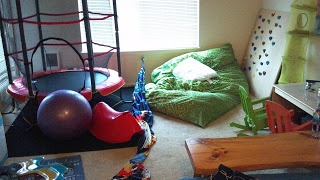 DIY conversion of a living room into a sensory room for two boys by Cup of Autism: Sensory stuff