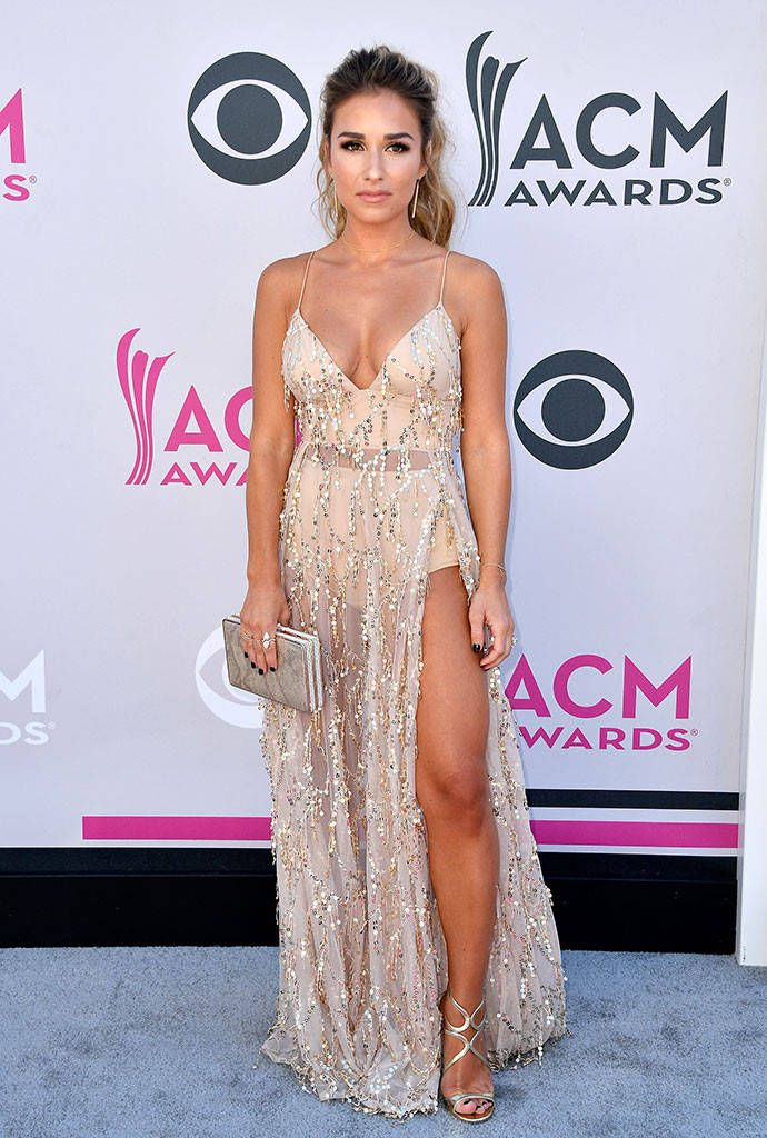 Jessie James Decker from ACM Awards 2017: Red Carpet Arrivals  Bronzed and beautiful! Jessie looks fierce as ever in a sheer gown with a thigh-high split.